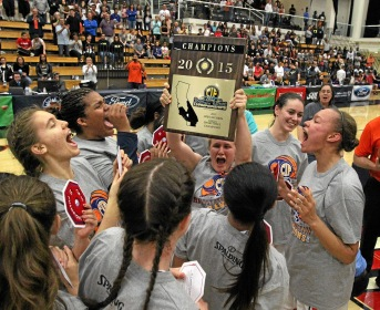 Chaminade's Paige Fecske (10), center raises the Championship plaque after Chaminade defeated Mater Dei 64-63 during Saturday night's CIF-SS Girls Basketball Open Division Finals at Azusa Pacific University in Azusa, CA Saturday, March 7, 2015. (Photo by Mark Dustin for the Daily Breeze)